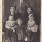 c1943, Maria's family standing is Nikolaos(Maria's father), Seated adults LtoR Anastasia (Maria's mother), Marigo (Maria's maternal grandmother)...