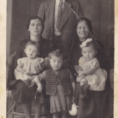 c1943, Maria's family standing is Nikolaos(Maria's father), Seated adults LtoR Anastasia (Maria's mother), Marigo (Maria's maternal grandmother)...