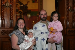 Father C, Presvytera Dina, and their children Maria and Joanna