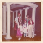 Maureen and Spiro Sakell with their Children at the 1974 Folklore, standing underneath columns made for Folklore decor