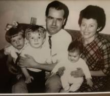 Paula (left) with her brother, sister, mother, and father