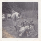 Louis doing a lamb roast at 'Uncle Tom Zakos's cottage; early 60s (1)