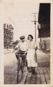 Zakos Siblings at princess street near their fruit store (Princess st and Barrie) - on the left one can see the YMCA building (now demolished)
