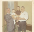 Chris's father holding Toni; Murva's father holding Jim