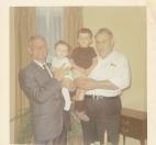 Chris's father holding Toni; Murva's father holding Jim
