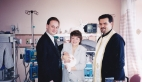 Fr. Theo, Shelley, Jim, and baby Christina on her 40 day blessing