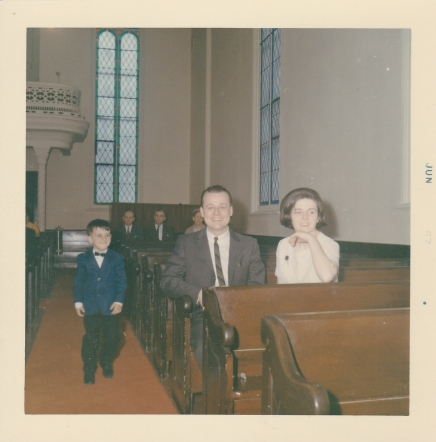 Jim's Christening - we can see the early interior of our church (old pews)
