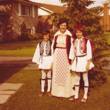 Murva with her two sons before folklore; Muva made all the costumes, except for the apron she is wearing which was made by her sister in law Kostoula